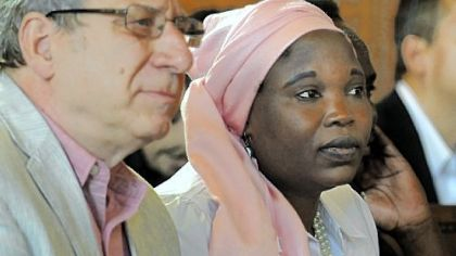 PDEC Coordinator David Rosenberg sits with Hawa  Abdullah, and activist and aid worker who was arrested and tortured by the Sudanese government before an international effort led to her release.