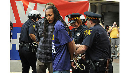 Some of the eleven people, from a crowd of more than 200, being  arrested in Downtown Pittsburgh Wednesday.