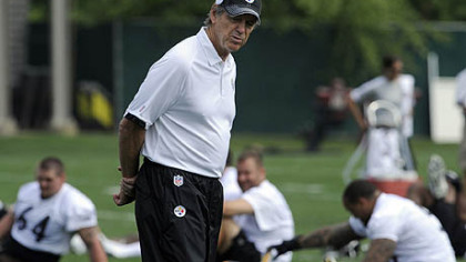 Steelers defensive coordinator Dick LeBeau watches over players during OTAs on the South Side Wednesday morning.
