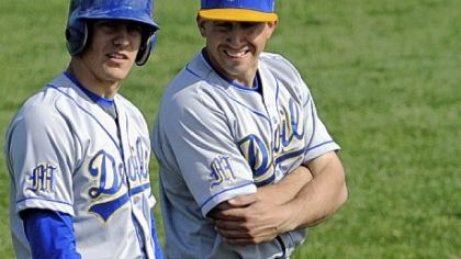 Senior outfielder Luke Hagy, left, confers with Mt. Lebanon coach Pat McCloskey during a game earlier this season.