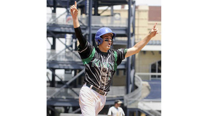 Allderdice&#039;s Braden Hoffer celebrates after scoring the go-ahead run against Brashear in the seventh inning of the City League baseball championship Thursday at PNC Park.