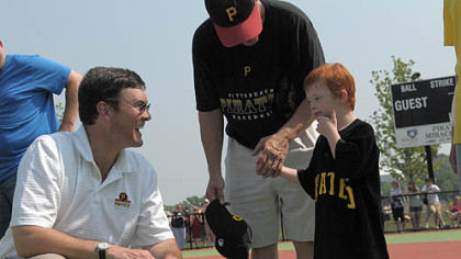 Pirates owner Bob Nutting, left, talks with &quot;Pirates&quot; team member Quintin Weismantle, 6, of Eighty-Four, after opening ceremonies for the new Miracle League Field at Boyce Mayview Park in Upper St. Clair. Quintin is accompanied by his father, Wayne Weismantle.