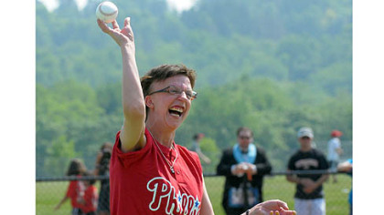 Genny Kanka throws out the first pitch at the first game Saturday on the newly opened Miracle League Field in Boyce Mayview Park in Upper St. Clair.