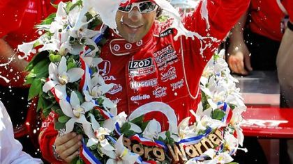 Dario Franchitti celebrates with the traditional jug of milk after winning the 96th Indianapolis 500.