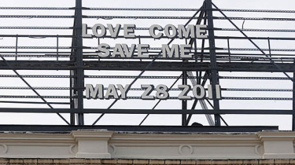 "A message on the billboard above the Waffle Shop read ""LOVE COME SAVE ME, MAY 28 2011"" on a recent day this month."