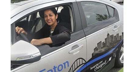 Revathi Advaithi, president of Eaton's entire North and South American region for Eaton's electrical sector based in Moon, sits in a Chevy Volt that is plugged in at an Eaton charging station in Moon.