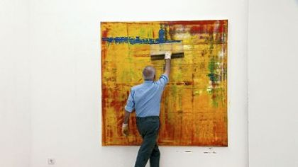 "Gerhard Richter working on Abstract Painting (910-1) in ""Gerhard Richter Painting."""