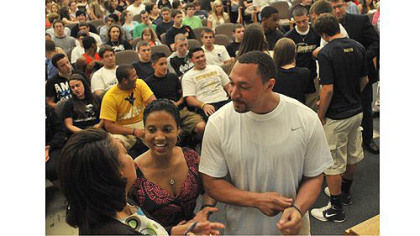 Steelers quarterback Charlie Batch and Latasha Wilson-Batch, center, talk with Candi Castleberry-Singleton, founder of the Dignity and Respect Campaign before an event at Brentwood High School to deal with an incident at a Brentwood-Monessen sporting event. The assembly, held in the Brentwood auditorium, included participants from Monessen.