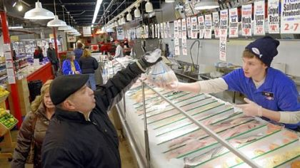 Rob Warywoda sells fish at Wholey&#039;s in the Strip District. His customer is Ed Lancia of Beechview.