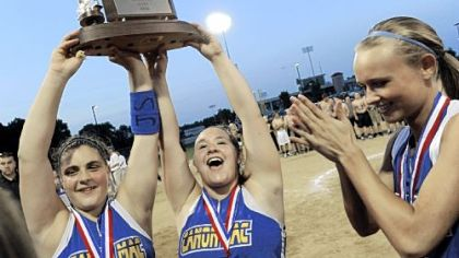 Canon-McMillan's Giorgiana Zeremenko and Alayna Astuto hold up the trophy after defeating Hempfield in the WPIAL Class AAAA championship Thursday at California University.