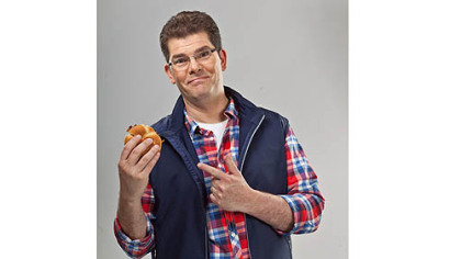 "'Fast Food Mania"" host Jon Hein with a chicken sandwich at the Harland Sanders Museum and Cafe in Corbin, Ky.  Colonel Sanders founded Kentucky Fried Chicken, also known as KFC."