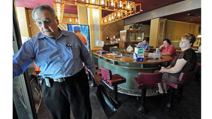 John Petrolias reflects on his closed Smithfield Cafe, a business started by his father in Downtown. Mr. Petrolias and his longtime workers are winding down the business after closing the doors to customers last Friday.