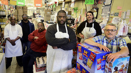Larry Turner, Lorrenzo Strozier, Al Strozier, Walt Andrews, Dave Kennedy and owner Louis Greenwald at Bell's Market in Braddock.