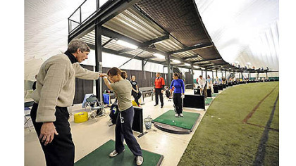 In this 2008 photo, instructor Jim Cichra (left) gives a golf lesson to Kendall Allen in the Golf Dome at Robert Morris University's Island Sports Center on Neville Island.