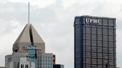 On Pittsburgh's downtown skyline, the headquarters of Highmark in view with the U.S. Steel Tower offices of UPMC. Gov. Tom Corbett says he wants the two health care giants to continue to work on a longer-term deal.