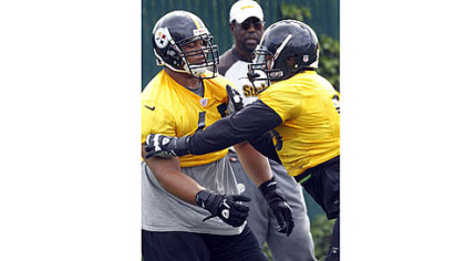 Ziggy Hood, right, works against fellow defensive end Al Woods in an OTA last month.