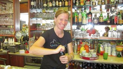 Simona serves beverages at Bar Arcobaleno in Quercianella.