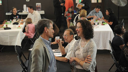 Robert Ruck, left, talks with Catherine Stephens, both of Squirrel Hill, at the tenth anniversary celebration of the Young Preservationists Association of  Pittsburgh on Saturday.