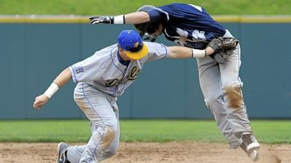 Mt. Lebanon's Ian Happ tags out McDowell's Alex Margraf at second base Monday in the first round of the PIAA playoffs.