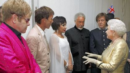 Queen Elizabeth II meets, from left, Sir Elton John, Sir Cliff Richard, Dame Shirley Bassey, Sir Tom Jones and Sir Paul McCartney backstage at the diamond jubilee concert in London Monday.