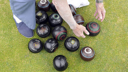 Ed Gannon of Regent Square picks his lawn bowling ball from the pile.