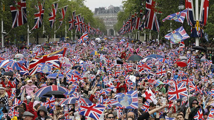 Revelers crowd the Mall in London Tuesday, seeking a glimpse of Queen Elizabeth II on the Buckingham Palace balcony as part of a four-day Diamond Jubilee celebration.