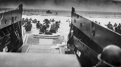 Troops wade ashore in Normandy, France, on June 6, 1944.