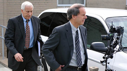 Jerry Sandusky and his attorney, Joe Amendola, leave the Centre County Courthouse after the first day of jury selection for Mr. Sandusky's trial.