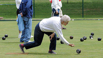 Helen Fickley of Penn Hills shows off her form during a lawn bowling match Tuesday at the public courts in Frick Park.