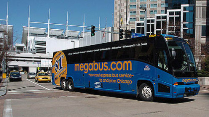 A Megabus in 2007 leaves the stop under David L. Lawrence Convention Center for its first Pittsburgh trip at 10th Street turning onto Liberty Avenue.