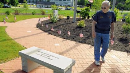 Moon Fire Marshal Charlie Belgie walks past one of the new benches at the 911 Memorial Garden at the Moon Township Municipal Building along Beaver Grade Road.
