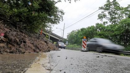 A landslide has restricted a portion of Clever Road to an alternating single-lane pattern and a temporary traffic signal has been installed to control traffic.