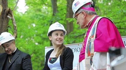 Bishop David A. Zubik, right, talks with Lillia Smyers, 14, of Ross, who will be starting ninth grade at North Catholic in the upcoming school year. The occasion is Saturday's groundbreaking for the new Cardinal Wuerl North Catholic High School in Cranberry.