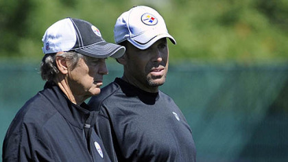 Steelers coordinators Dick LeBeau (defense) and Todd Haley (offense) talk during organized team activities Wednesday at the South Side practice facility.