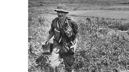 Eddie Adams covers action in South Vietnam in 1965 for The Associated Press.