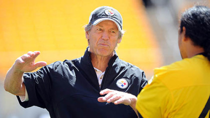 Steelers defensive coordinator Dick LeBeau talks with Troy Polamalu during organized team activities Thursday at Heinz Field.