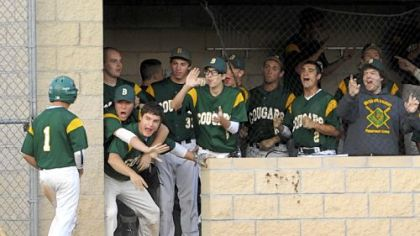 The Blackhawk players in the dugout celebrate the run scored by Zach Hildebrand, far left, Thursday against Thomas Jefferson at North Allegheny. Blackhawk won, 6-1.