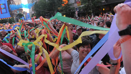 Ribbons cover the crowd at the Pride in the Street party on Liberty Ave., Downtown.