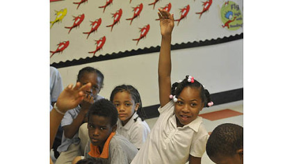 Makita Carter raises her hand during a morning meeting of third-graders in May at Faison K-5 in Homewood.