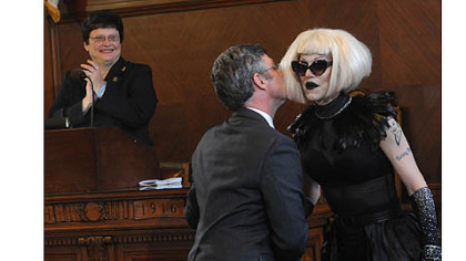 Pittsburgh city councilor Patrick Dowd congratulates drag queen Sharon Needles with a kiss after council declared June 12, 2012 Sharon Needles Day in Pittsburgh.