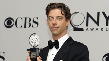 "Christian Borle with his Tony -- ""It is fantastically heavy, and it does spin."""
