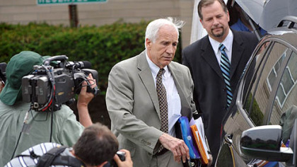 Jerry Sandusky leaves the Centre County Courthouse following the first day of testimony in his trial.