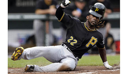 Pirates outfielder Andrew McCutchen loses his helmet as he slides into home plate for a run on a single by Matt Hague in the first inning Tuesday night in an 8-6 loss to the Baltimore Orioles.