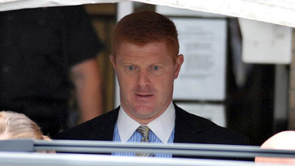 Mike McQueary, a Penn State assistant football coach who is currently on leave, exits the Centre County Courthouse on Tuesday after testifying for two hours.