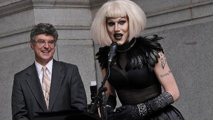 After having a proclamation read in city council proclaiming June 12, 2012, as Sharon Needles Day in Pittsburgh, Ms. Needles speaks on the portico of the City-County Building before performing for her fans. At left is Councilman Patrick Dowd, who sponsored the proclamation.
