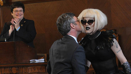 "After reading a proclamation in City Council honoring drag queen Sharon Needles, right, Councilman Patrick Dowd gives her a kiss as Council President Darlene Harris reacts in the background. Ms. Needles is the most recent winner of ""RuPaul's Drag Race,"" a television competition."