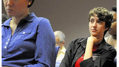 J. Wester, a member of the LGBTQ Advisory Council, listens to panelists during a town hall meeting Wednesday night at the Allegheny County Department of Human Services building, Downtown.