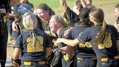 Montour teammates celebrate their win against Elizabeth Forward in the WPIAL Class AAA championship in May.