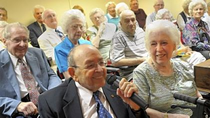 At a ceremony honoring couples married for 50 years or longer at St. Barnabas last Thursday, Charles Cannoni talks about how he met his wife Lena, right. The Cannonis have been married for 65 years and were celebrating their anniversary, having wed on June 7, 1947.