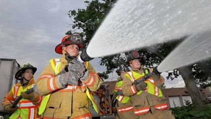 From left, Clairton volunteer firefighters Phil Marra, Jesse Dinkel, William Smoyer and Jesse Fruciano demonstrate using their fire hoses outside their station in Clairton.